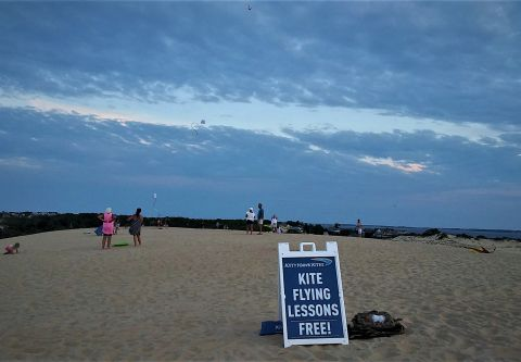 Free kite lessons by Kitty Hawk Kites at Jockey's Ridge State Park
